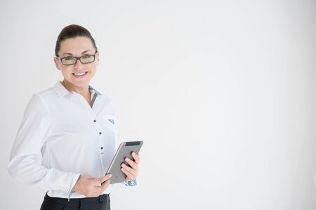 disposer: Mature Businesswoman with Digital Tablet in Office Stock Photo