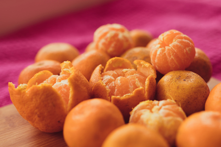 orange peel clove: tangerines, orange slices, stars cardamom and cinnamon sticks on a wooden table