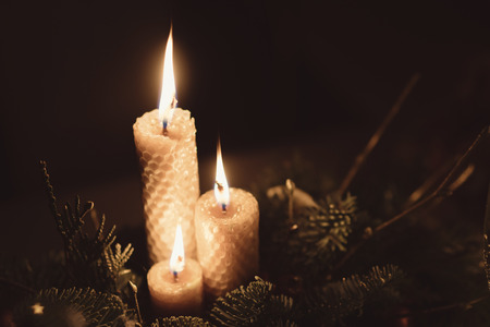 flower shape: christmas table arrangement with burning candles and champagne