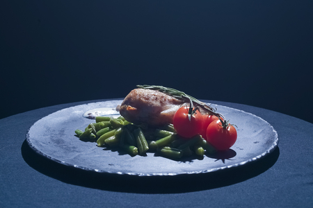 vin: chicken steak with salad, raw tomatoes on plate Stock Photo
