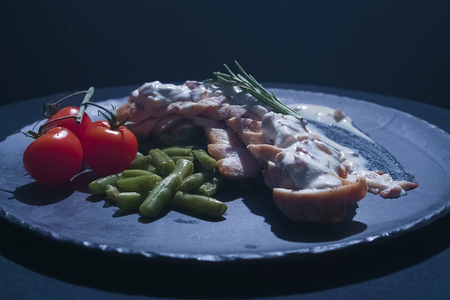 chicken steak with salad, raw tomatoes on plate Stock Photo
