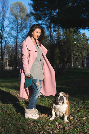 Young woman with her dog in the park Stockfoto