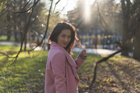 Beautiful adult woman in the sunlight