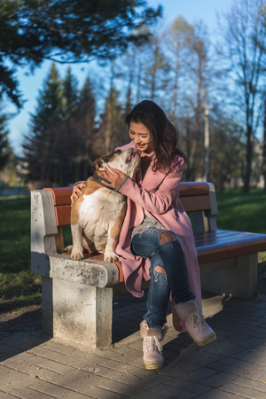 Happy woman with her dog in the park Stockfoto