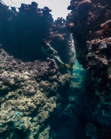 Young woman freediving in Egypt caves