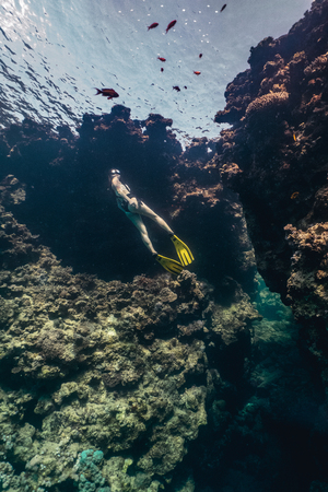 Young woman freediving near blue hole, Egypt