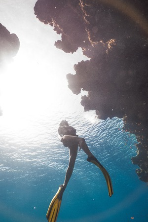 Asian girl freediving in famous Bells, Egypt
