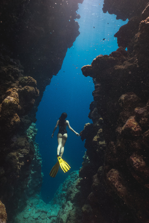 Asian woman freediver in famous Bells, Egypt 스톡 콘텐츠