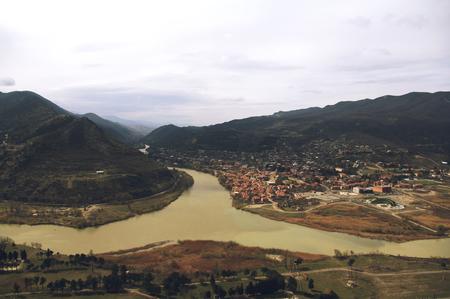 Panoramic view from the Jvari Monastery overlooking the town of Mtskheta and the joining of Mtkvari (Kura) and Aragvi rivers, Georgia.