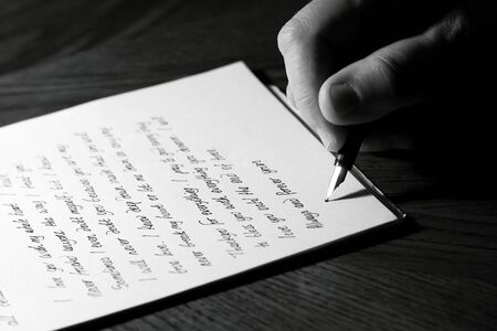 Man writing a love letter with a fountain pen