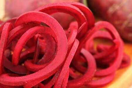spiralized: Spiralized beetroot on a wooden chopping board