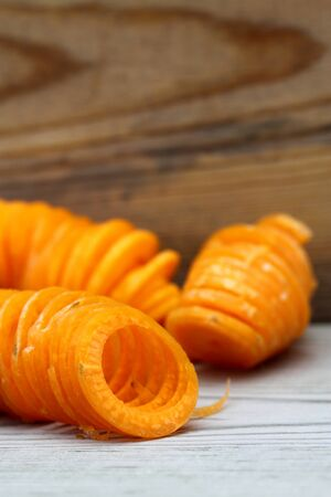spiralized: Spiralized carrot on a wooden background Stock Photo