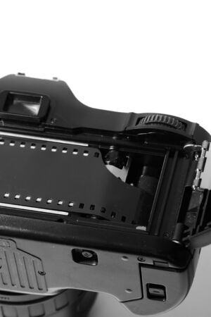 loaded: Vintage retro camera with a strip of film loaded Stock Photo