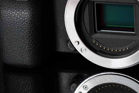 cmos: APS-C CMOS sensor on a mirrorless digital camera Stock Photo