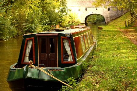 Canal barge moored in the countryside Stock Photo