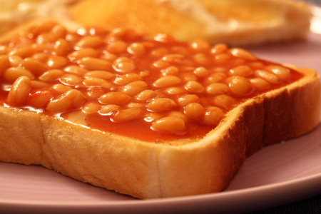 carbohydrates: Beans on toast on a plate