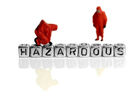 hazardous material team: Miniature scale model team in chemical suits with the word hazardous on beads