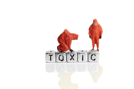 hazardous material team: Miniature scale model team in chemical suits with the word toxic on beads