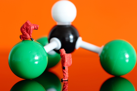 structural formula: Miniature model chemical team with a molecular model of chloroform