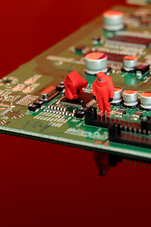Miniature scale model chemical team on a circuit board Stock Photo