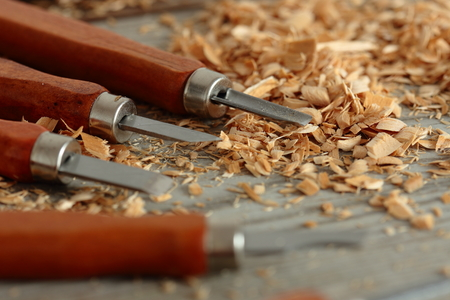 Chisels on a wood background with shavings Stock Photo