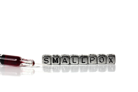 Syringe and blood with the word Smallpox on beads