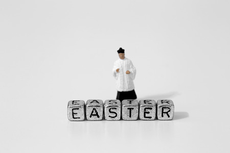 Miniature scale model priest with Easter on beads