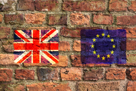 United Kingdom Union Jack and the European Union flags on a brick wall. Concept that brexit negotiations have hit a brick wall. Archivio Fotografico