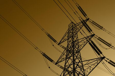 Electricity pylon with power cables, in the United Kingdom, against a toned sepia sky