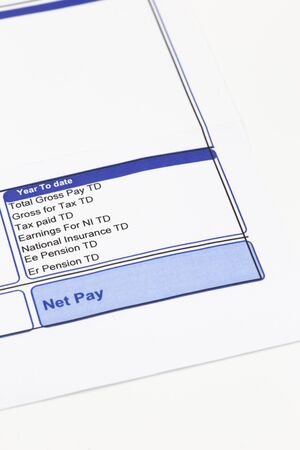 Wage pay slip showing pension, national insurance and tax earnings deductions.  Isolated on a white background
