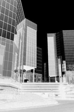 Abstract image of a modern office building.  Black and white negative inverted image. Stock Photo