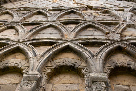 Stone carving on a wall of a medieval priory abbey