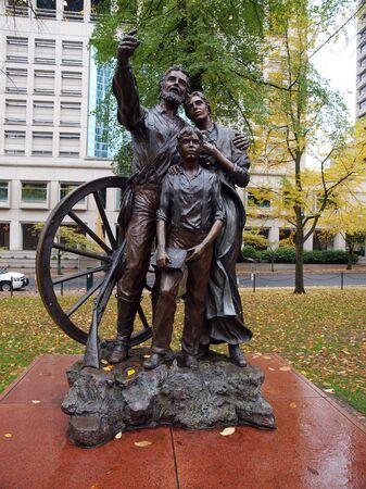 pioneers: Statue of pioneers in downtown Portland OR.