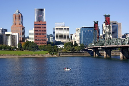 Looking at the Portland Skyline and a boat on the river.