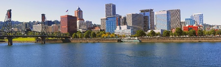 Skyline view of Portland Oregon, the Hawthorne bridge and the Portland Spirit ship.  Stock Photo