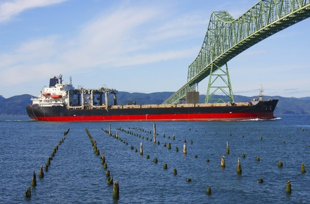 Cargocargo ship & the Astoria bridge  Stock Photo