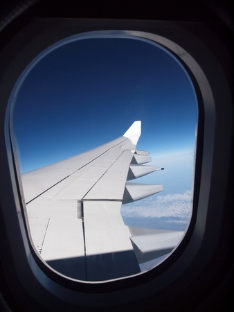 travel industry: Airline window wing.     Stock Photo
