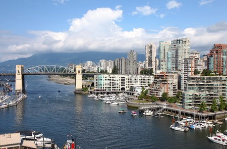 bc: Granville Island & high rises dwellings, Vancouver BC Canada.