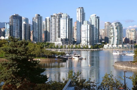 Vancouver BC waterfront False creek bay south side & sailboats. Stock Photo