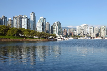 Vancouver BC waterfront False creek bay south west side & sailboats.