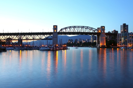 The Burrard bridge in Granville island Vancouver BC Canada at dusk.