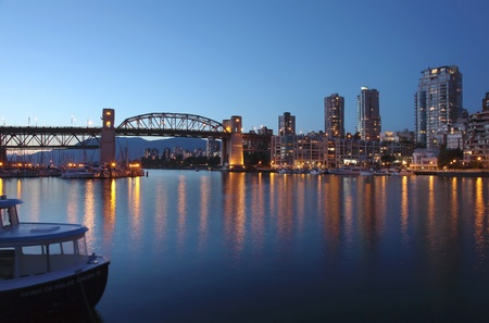 The Burrard bridge False creek & urban surroundings at sunset, Vancouver BC Canada.