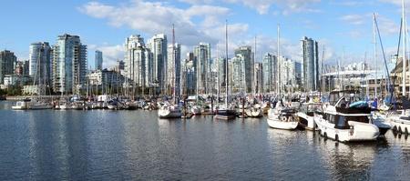 A panorama of False Creek marina and the south Vancouver BC skyline, Canada.  photo