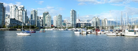 A panoramic view of False creek & Vancouver BC skyscrapers.