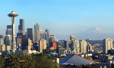 A panoramic view of the city of Seattle skyline and Mt. Rainier at sunset.