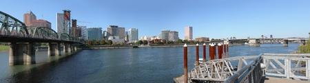 A panorama of Portland Oregon skyline & two bridges. photo