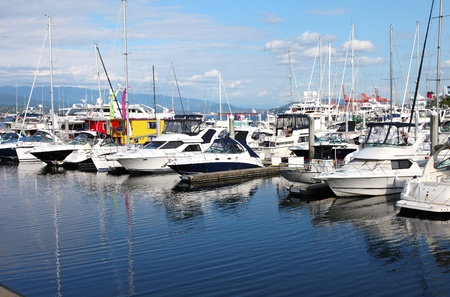 Yachts & sailboats moored in a marina in Vancouver BC. Canada.