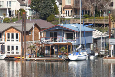 Two level floating house and a power boat, Portland OR