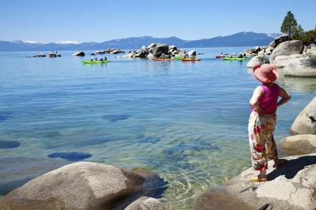 Team of kayaks paddling together in Lake Tahoe, CA