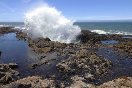 A large explosive splash in Thor s well Oregon coast  photo